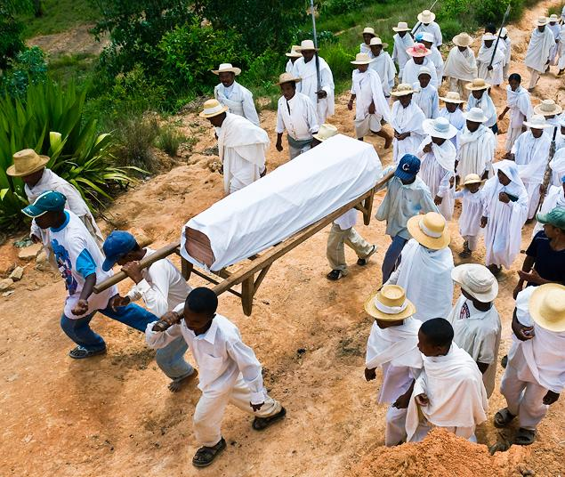 Dead man comes back to life at HIS OWN funeral