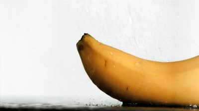 stock-footage-delicious-banana-in-super-slow-motion-receiving-water-against-a-white-background