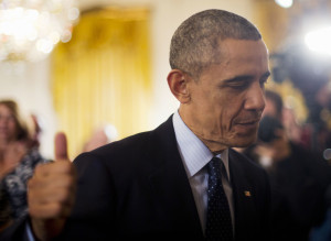 President Barack Obama gives a 'thumbs-up' after awarding the National Medals of Science and National Medals of Technology and Innovation, Thursday, Nov. 20, 2014, in the East Room of the White House in Washington. On Thursday night, the president is poised to level broad authority to grant work permits to millions of immigrants living illegally in the US and to protect them from deportation, but the plan would leave the fate of millions more still unresolved. Republicans vowed an all-out fight against it.  (AP Photo/Pablo Martinez Monsivais)