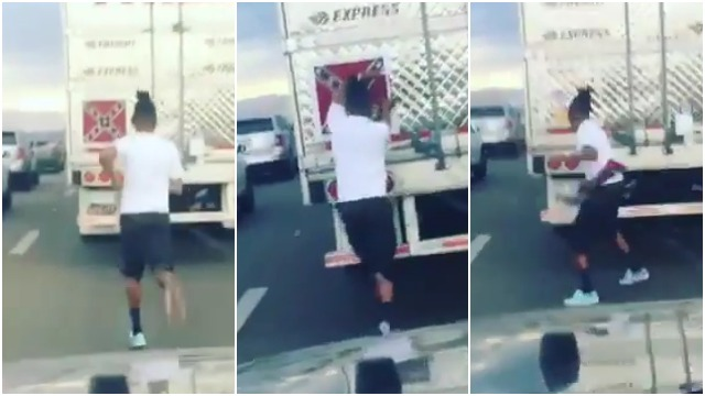 Man removes Confederate flag off the back of truck during traffic